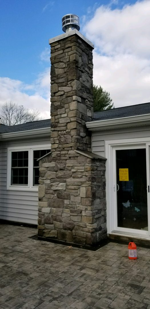 Brick stone chimney gallery crown flue repair for Stone chimneys